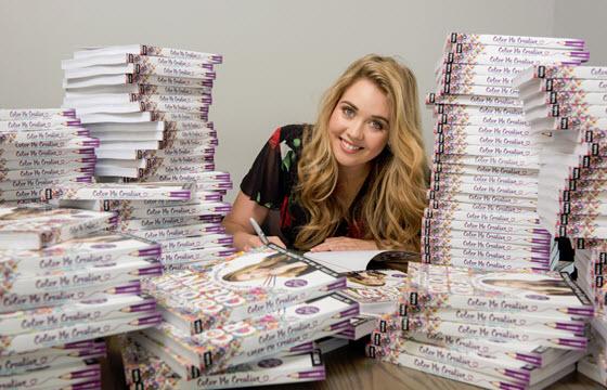 Kristina Webb signing many books